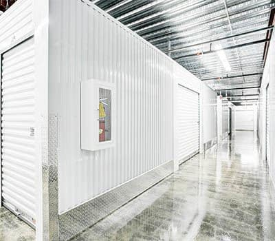 Indoor, climate controlled hallway at a storage facility.
